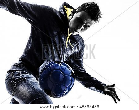 one caucasian young man soccer frestyler player  in silhouette  on white background