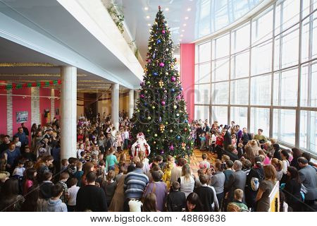 MOSCOW - DEC 30: People gather at New Year tree at the Cultural Center ZIL, December 30, 2012, Moscow, Russia. In December 2012 Centre celebrated its 75th anniversary.
