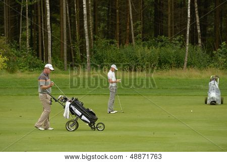 MOSCOW, RUSSIA - JULY 28: Alastair Forsyth of Scotland (left) and Jurgen Maurer of Austria during final round of the M2M Russian Open at Tseleevo Golf & Polo Club in Moscow, Russia on July 28, 2013