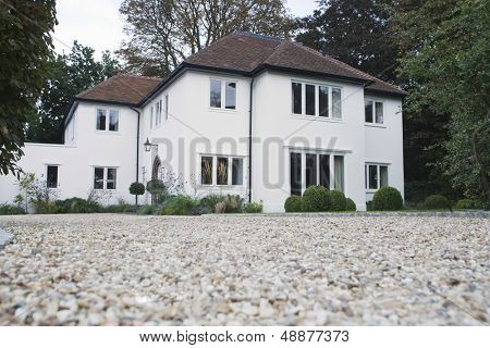 House exterior with surrounding yard and driveway