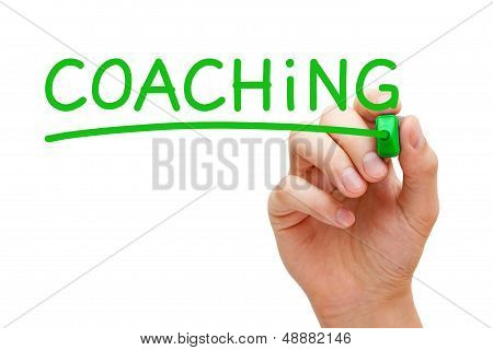 Hand writing Coaching with green marker on transparent wipe board. poster