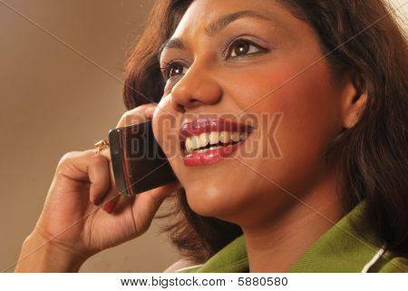 Beautiful indian woman talking on phone