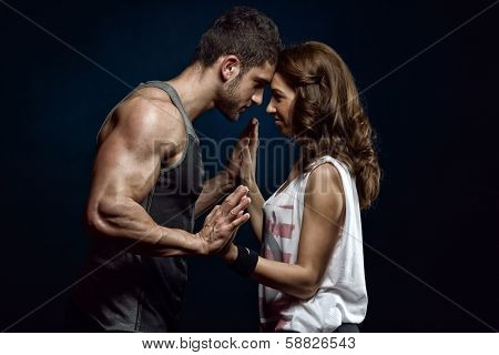 young athletic couple in studio