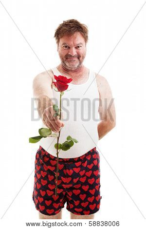 Scruffy looking guy in his underwear handing you a single red rose.  Isolated on white.