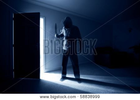 Burglar breaking into a house and threatening with a knife