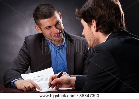 Naive Man Signing The Usury Contract