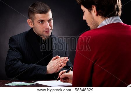 Moneylender Talking With Client