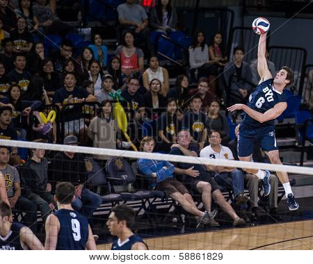 IRVINE, CA - JANUARY 17: Brigham Young University's Josue Rivera serves in a volleyball match with the University of California - Irvine at the Bren Events Center in Irvine, CA on January 17, 2014