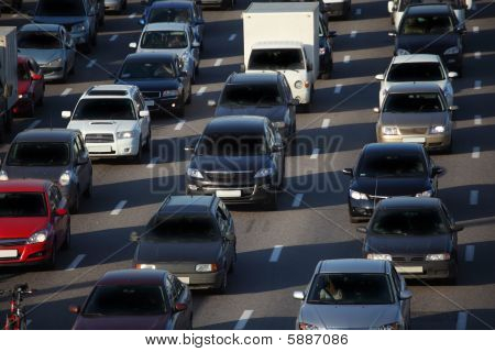 red car in big urban traffic, sunny day poster