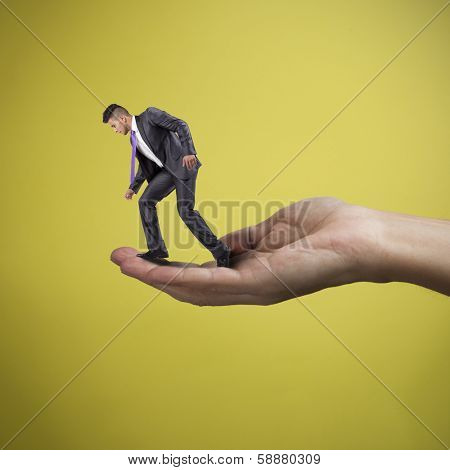 Hand holding and helping a young businessman