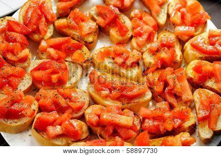 Juicy tomatoes on fresh bread, bruschetta