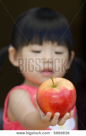 A little child hold an red apple