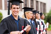portrait of group cheerful college graduates at graduation poster