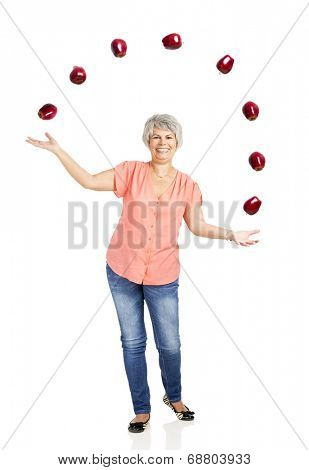 Old woman throwing apples, isoalted over white background