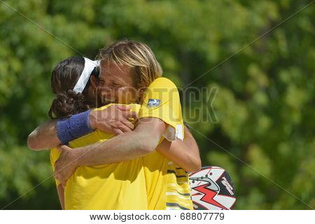 MOSCOW, RUSSIA - JULY 19, 2014: Vinicius Font and Joana Cortez of Brazil celebrate the victory in the match against Spain during ITF Beach Tennis World Team Championship. Brazil won 2-1