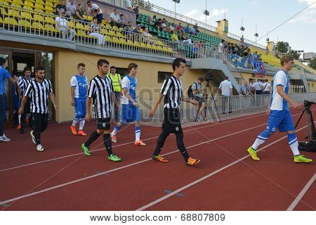 MOSCOW, RUSSIA - JULY 21, 2014: Teams come out on the field before the match Dynamo, Moscow - PAOK, Greece during Lev Yashin VTB Cup, the international soccer tournament for U21 teams. Dynamo won 3-2