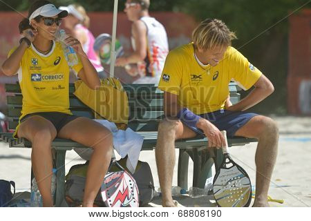 MOSCOW, RUSSIA - JULY 19, 2014: Vinicius Font and Joana Cortez of Brazil in the match against Spain during ITF Beach Tennis World Team Championship. Brazil won 2-1
