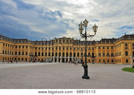 Hofburg - the winter residence of the Austrian Habsburg emperors. Palace and vintage lamps on a large area