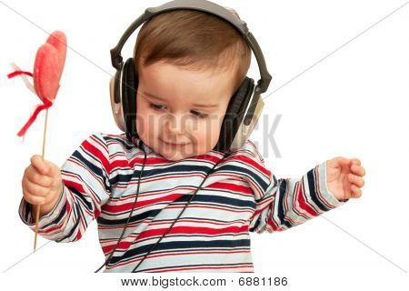 Kid In Striped Shirt With Headphones And Red Heart