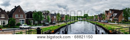 Dull Assen With Canal.  Holland.