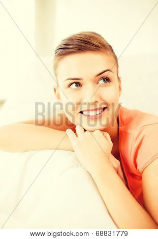 brigh picture of smiling woman lying on the couch
