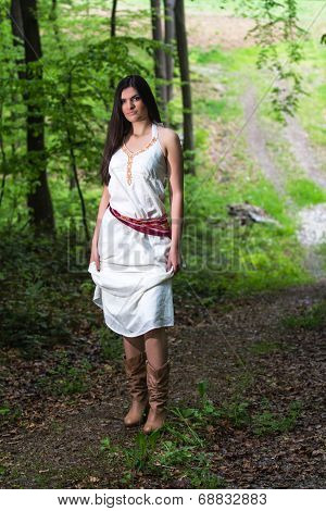 Young Woman In A Forest Enjoying
