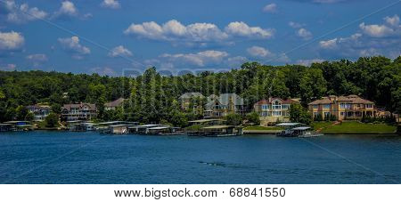 Lake of the Ozark houses on summer day