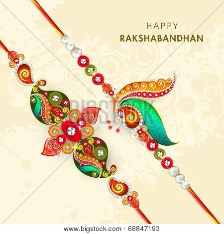 Beautiful peacock feathers decorated rakhi on beige background for the occasion of Raksha Bandhan celebrations.