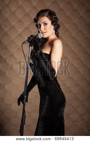 Beautiful Brunette With A Microphone Sings A Song On Stage