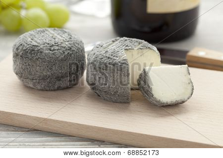 Fresh crottin cheese and a slice