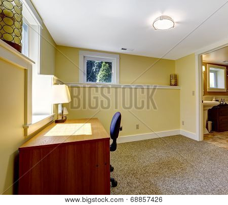 Empty Office Room With Bookshelf And Desk