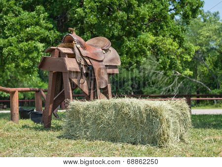 Leather Horse Saddle And A Hay Bale