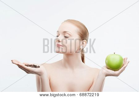 Closeup portrait of young woman holding coffee beans and green a