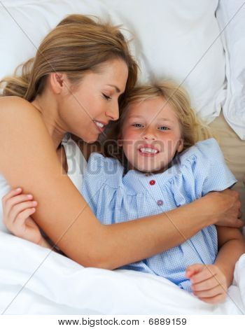 Cute Little Girl Hugging With Her Mother