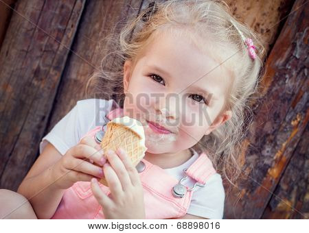 Little Girl Eating An Ice-cream