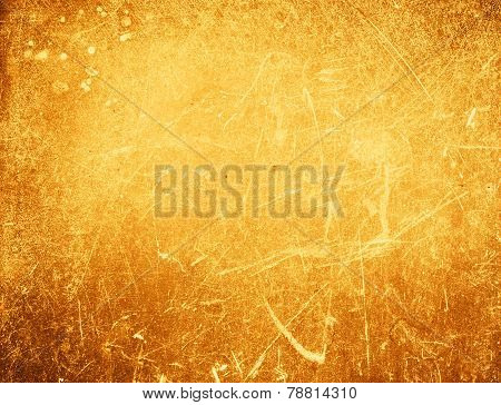 Abstract Gold Textured  Background With Spotlight And Scratches. Yellow Grunge Wall Closeup For Desi