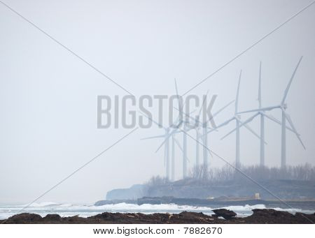 Windmills In Winter Mist