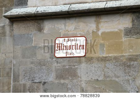 road sign with the name of the street in vienna in the wall of church poster
