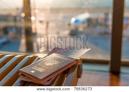 Passports And Tickets On A Background Of An Airplane