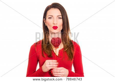 Gorgeous girl in red kissing valentine isolated