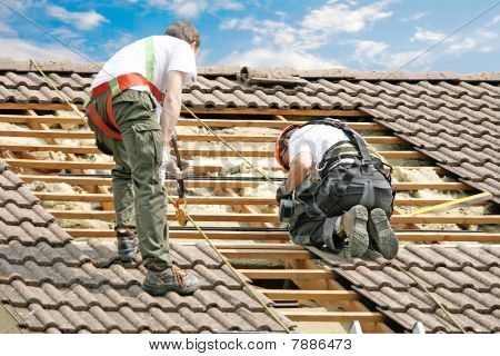 Two man performing roof heat insulation, France poster