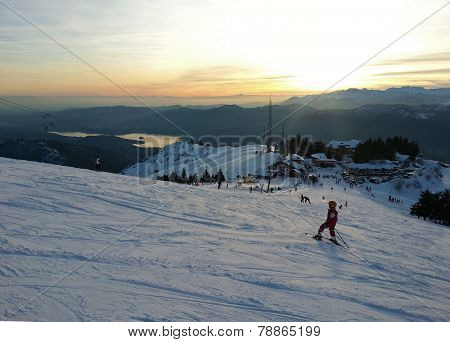 Young Skier going down the slope at Monterone Alps Italy