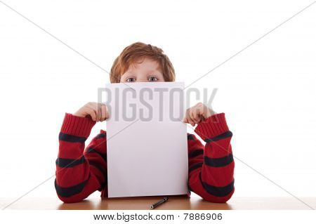 Kid Holding A White Sheet Of Paper In His Hand