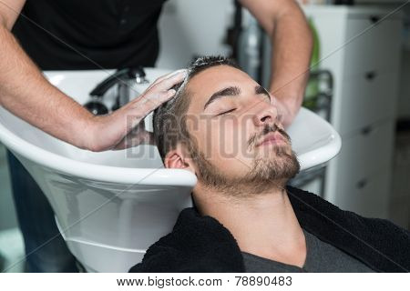 Portrait Of Male Client Getting His Hair Washed