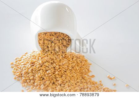 Organic Gold Flaxseed Heap On White Background