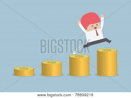 Happy Businessman Jumping On The Money Step