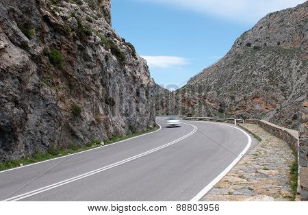 Car Passing A Gorge In Crete, Cyprus