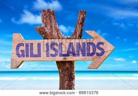 Gili Islands wooden sign with beach background