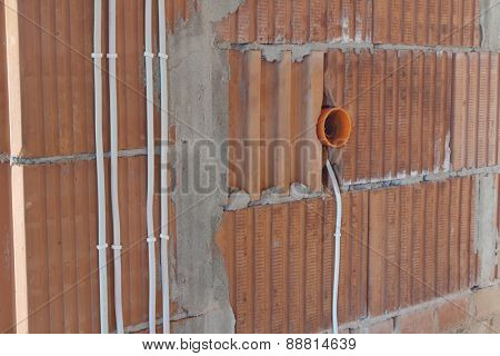 electrical conduit on the brick wall