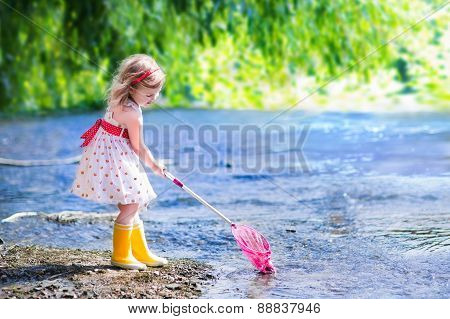 Little Girl Playing In A River